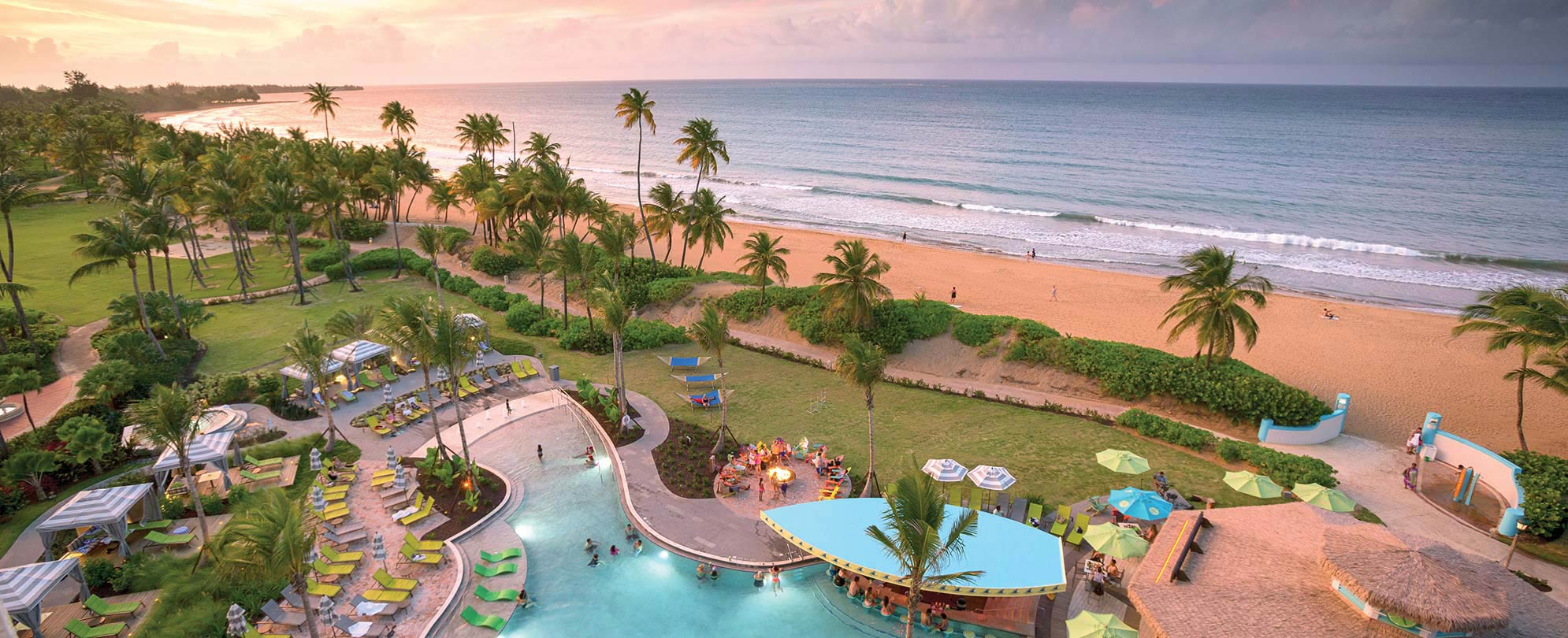 Birds-eye-view of the oceanfront pool at Margaritaville Vacation Club by Wyndham - Rio Mar timeshare resort in Puerto Rico.