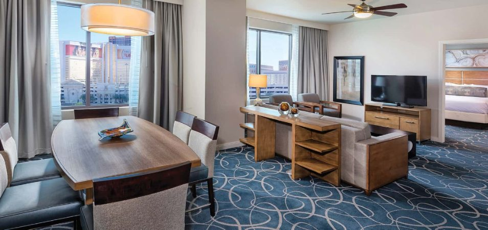 Dining room table, living room, and bedroom in a spacious Margaritaville Vacation Club resort suite.